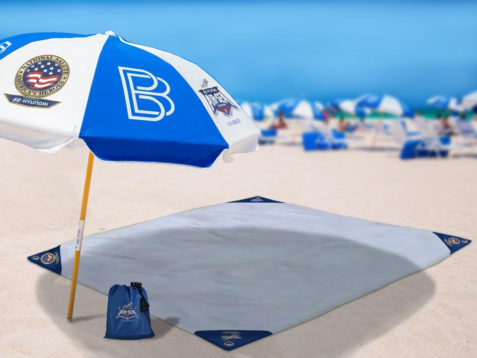a blanket and umbrella on the beach