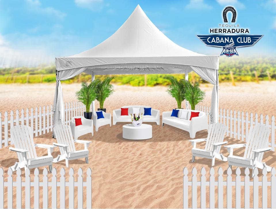 a cabana on the beach with chairs and couches