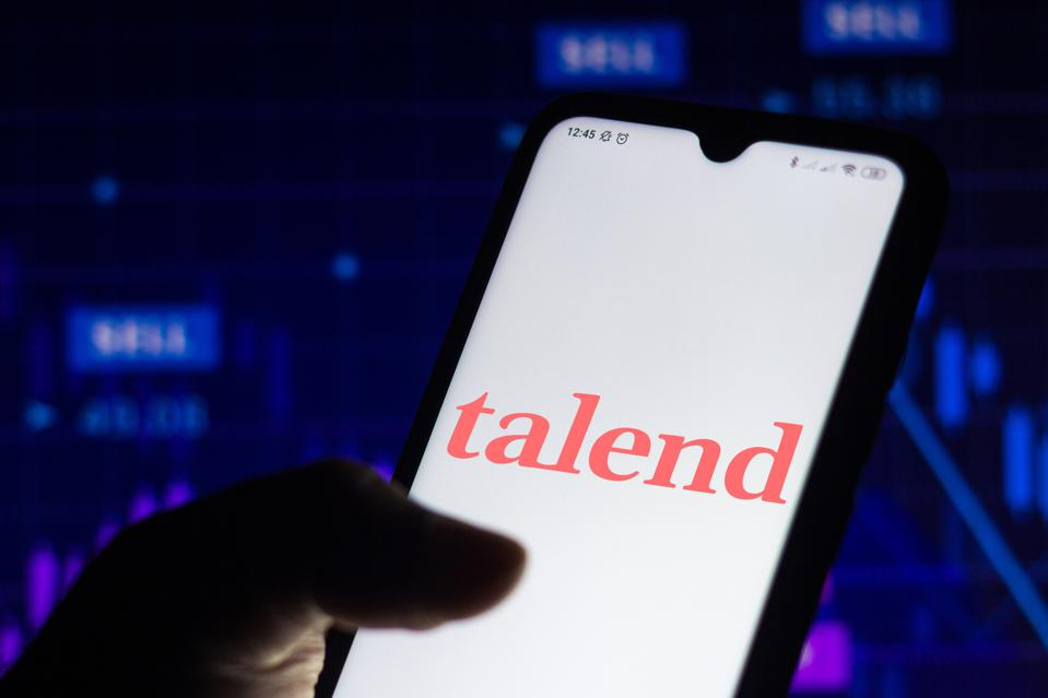 In this photo illustration the Talend Data Fabric logo seen...