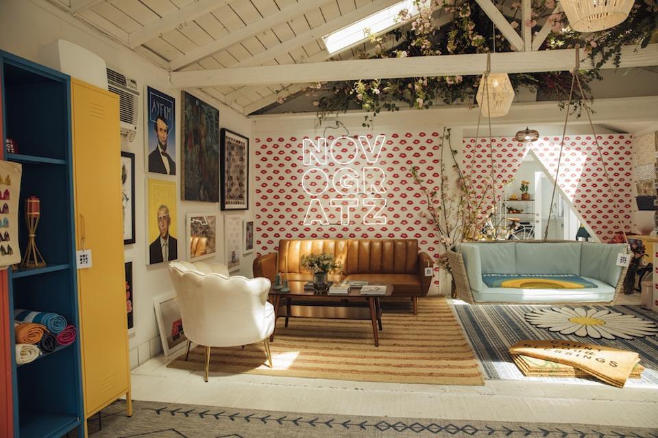 Interior of House Of Novogratz with a sofa, chair, rugs, lockers, etc.
