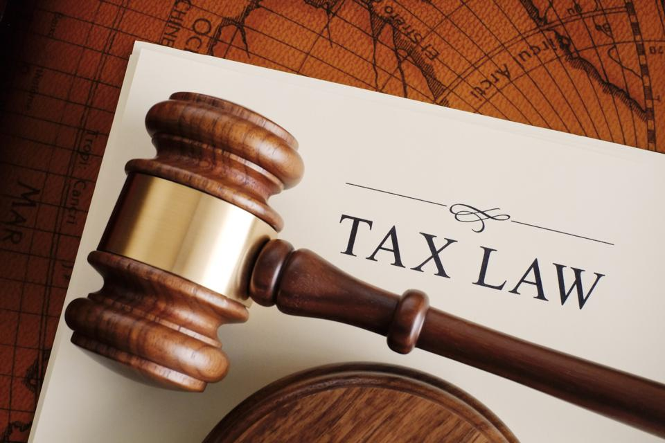 Brown gavel on a white tax law document