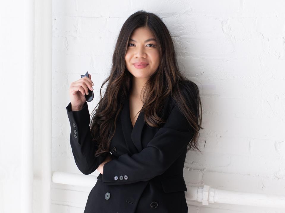 Métange founder Tanya Riz Tan smiles in a black jacket.