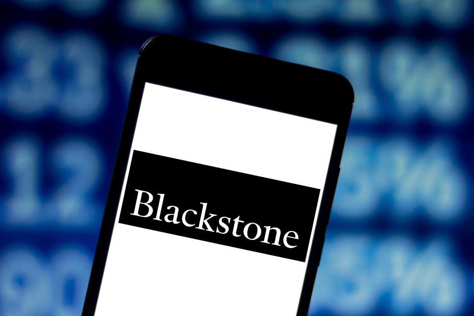 In this photo illustration the Blackstone Group logo is seen...