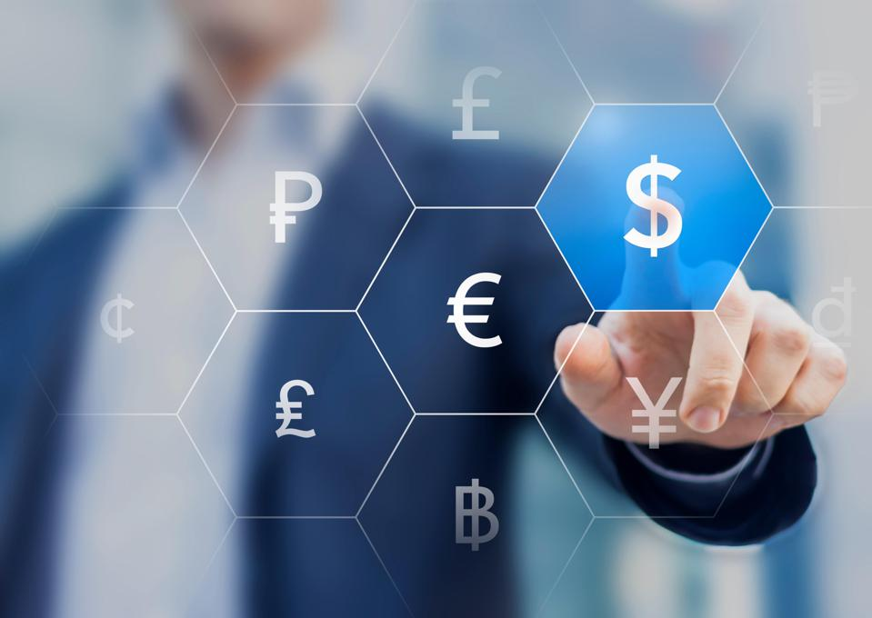 Businessman presenting currencies on virtual screen and touching dollar sign