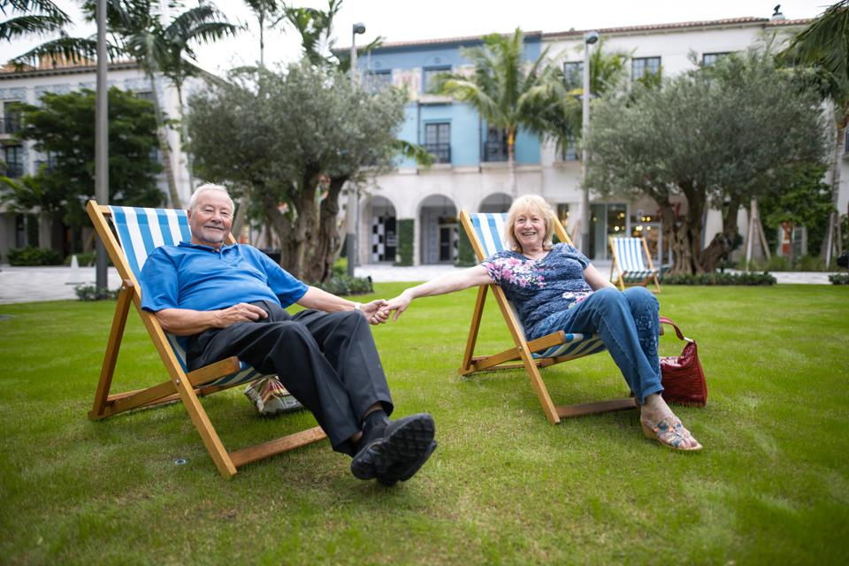 Two seniors relaxing at Rosemary Square in West Palm Beach, Florida.