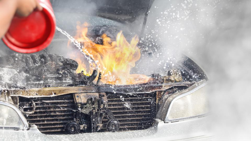 Car burning at parking lot because electrical short problem
