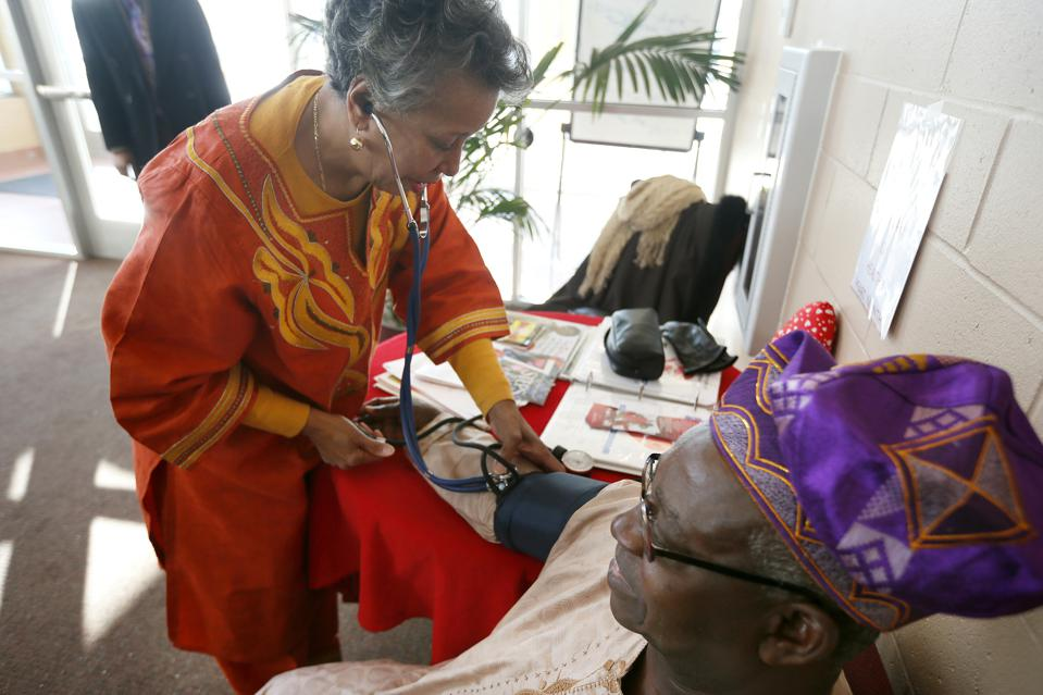 Beverly Propes a member of Fellowship Missionary Baptist Church spent  Sunday Feb 9 , 2014 checking church member Abe Kuku  blood pressure after morning services at the church  in Minneapolis, MN.  These days, she spends a lot of time preaching on how to