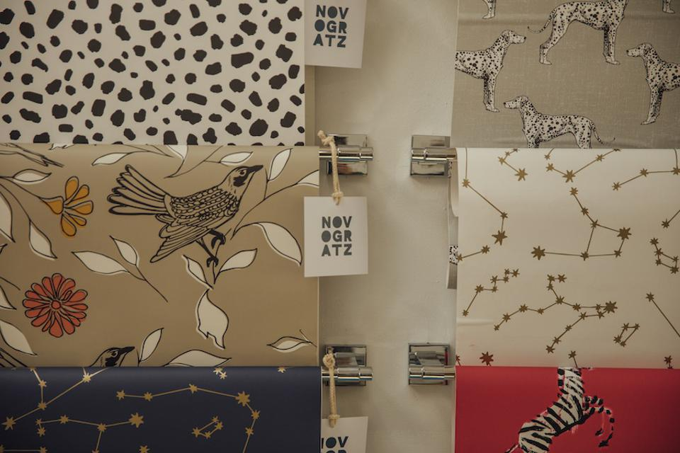 Sheets of peel and stick wallpaper on a display
