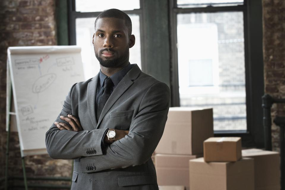African American businessman standing in new office