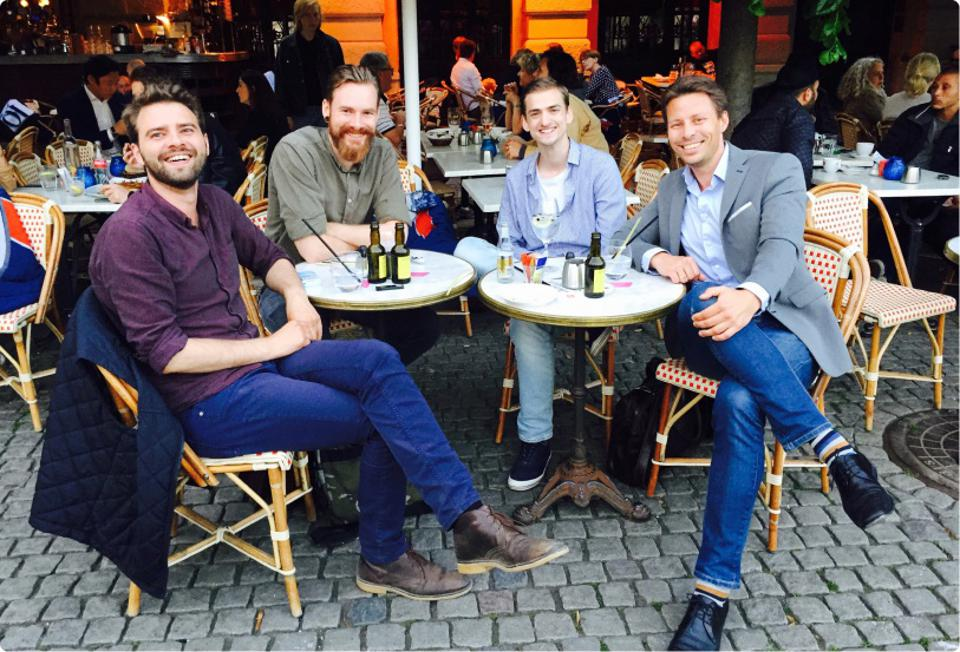 The four Dixa founders celebrate the founding of the company in 2015, at an outdoor cafe. From left: Jacob Vous Petersen, Jakob Nederby Nielsen, Krisztian Tabori, and now-CEO Mads Blicher Fosselius