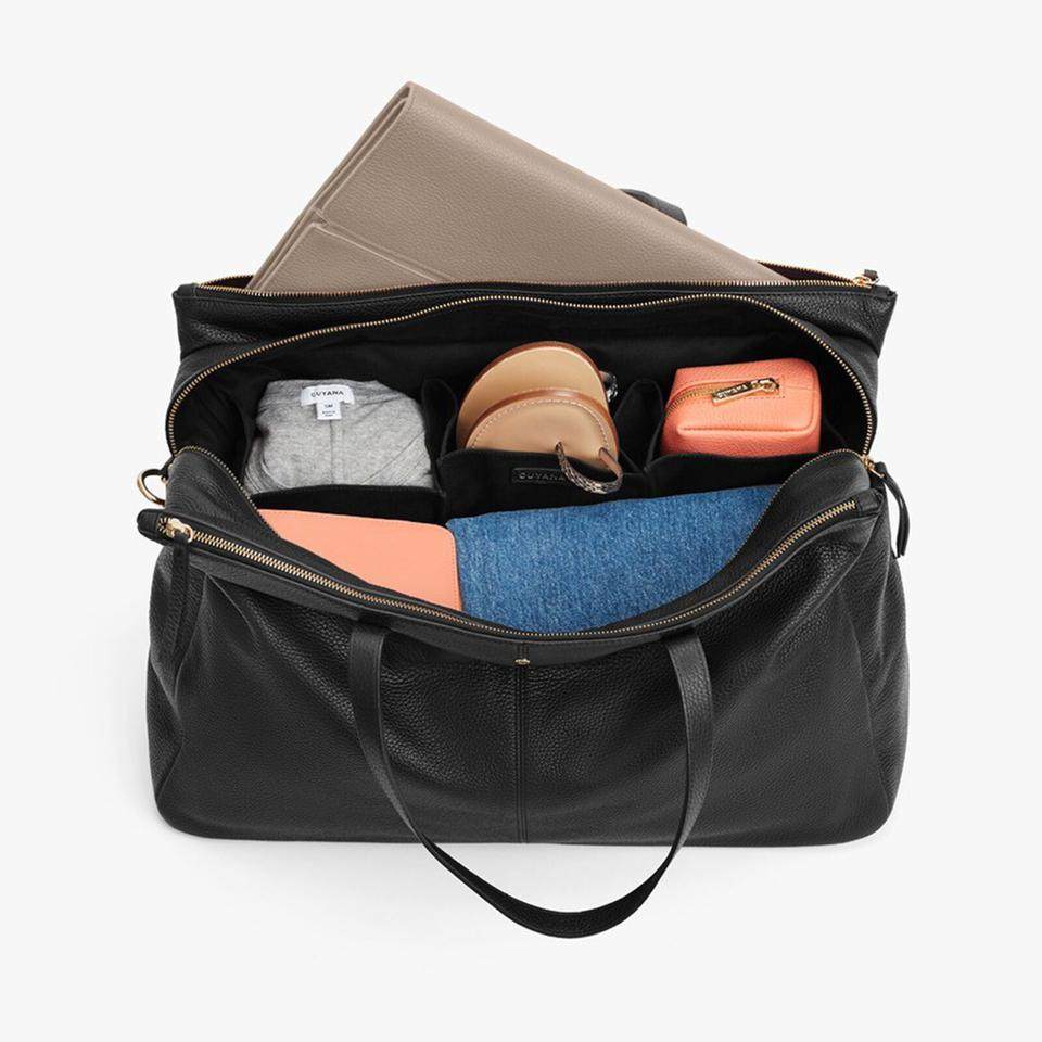 black bag with items in it