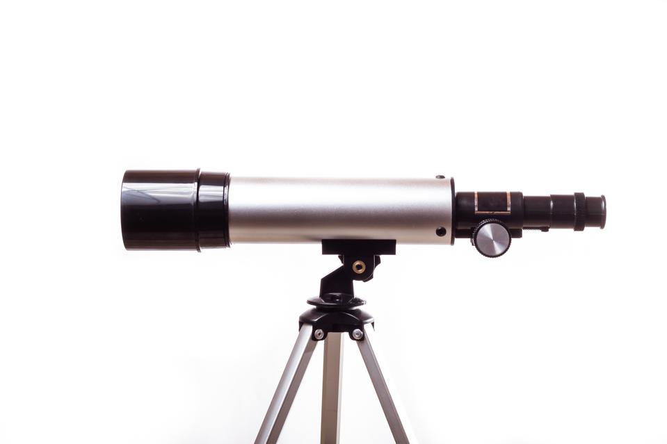 Close-Up Of Telescope Against White Background