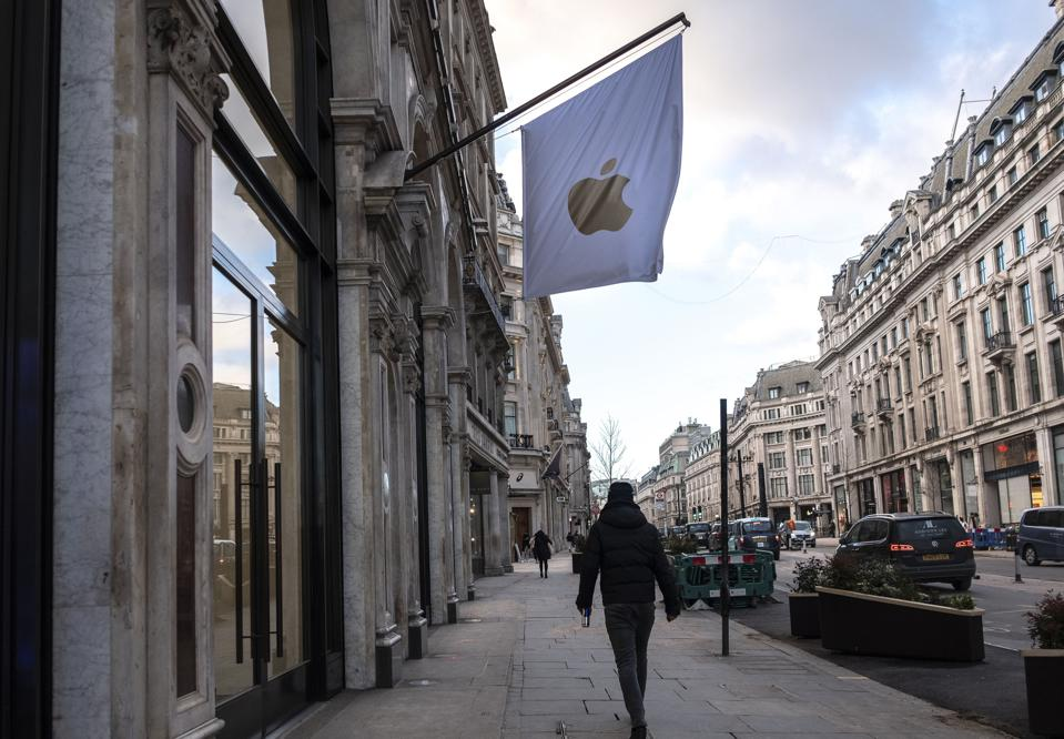 A man walking past the Apple stores  in London, during the...
