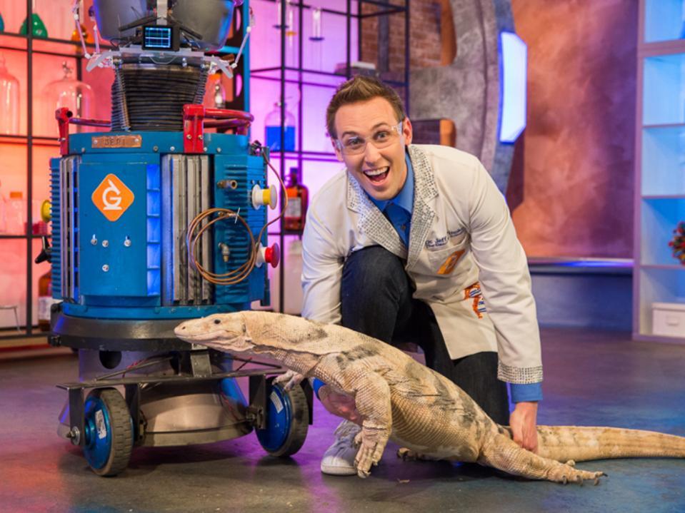 Vinokur with a large lizard on set.
