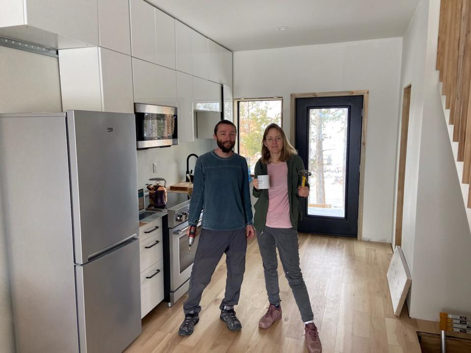 The homeowners in the main unit during construction.