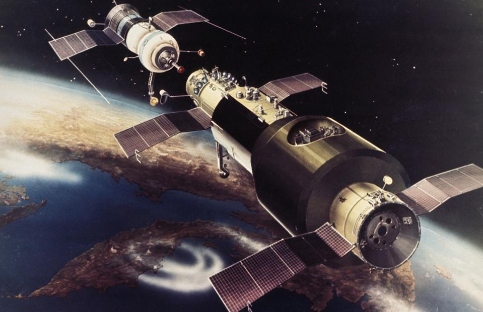 Artist's rendering of a soyuz space craft docking with the salyut 1 orbiting space station, launched in 1971, it was the first soviet space station.