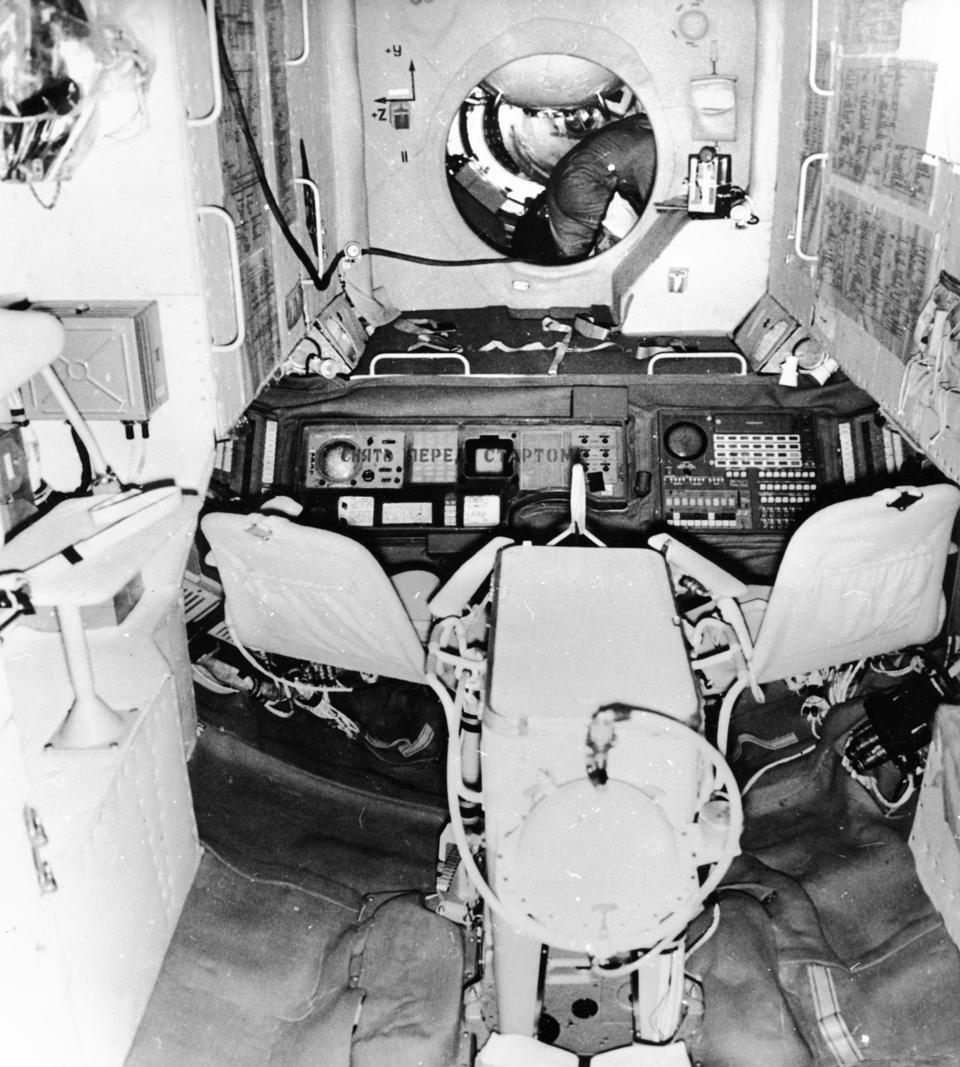 The interior of the salyut 1 space station with the hatchway leading to the soyuz 11 spacecraft, june 1971.