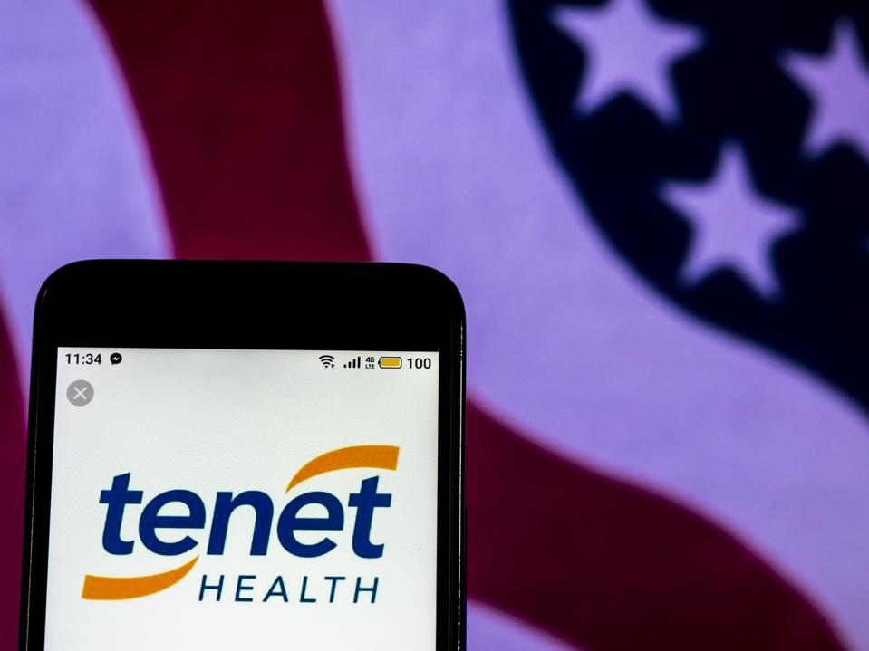Tenet Healthcare company logo seen displayed on a smart