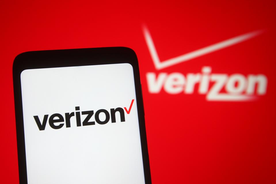In this photo illustration, Verizon logo seen displayed on a...