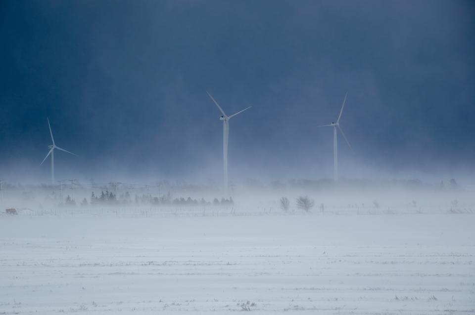 Alternative energy wind turbines in a snow storm