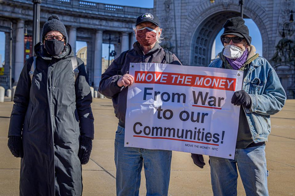 Participant seen holding a sign at the protest. Anti-War...
