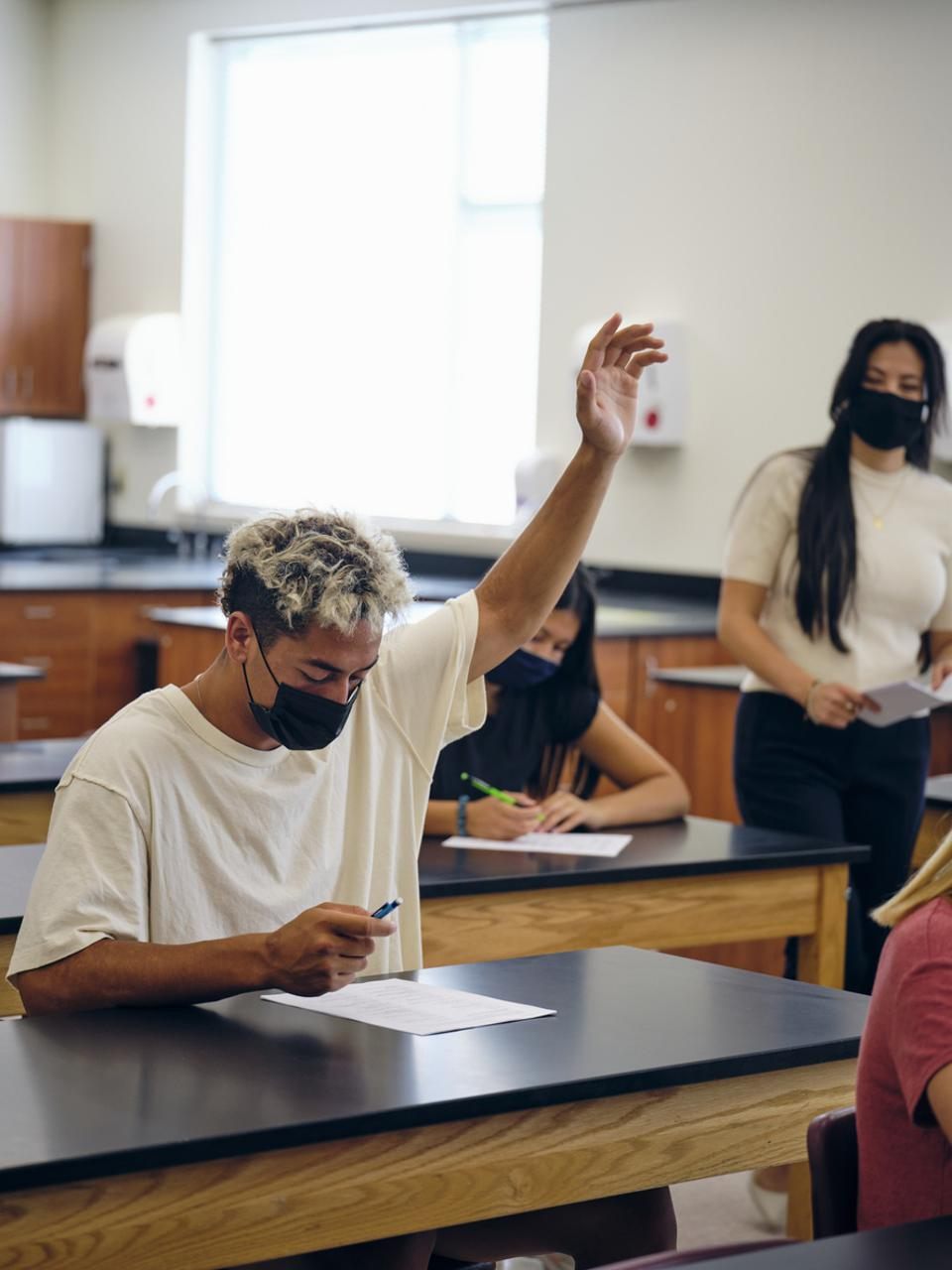 High School Teacher and Students In Classroom Wearing Protective Face Mask