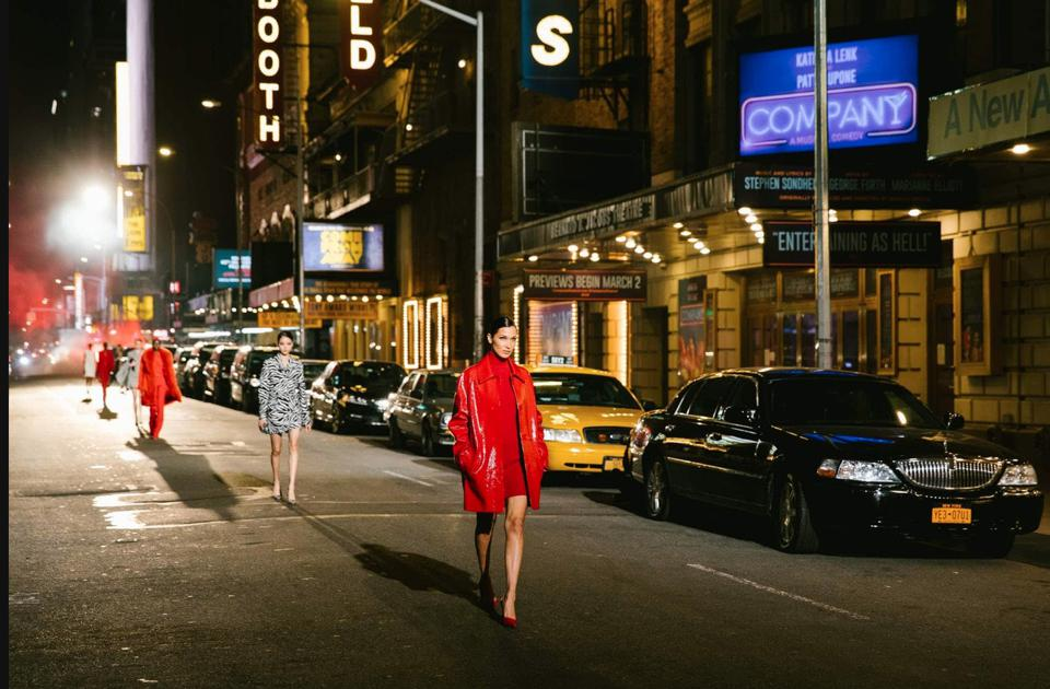 Models dressed in Michael Kors light up Broadway's dimmed lights since the pandemic closed theaters in March 2020.