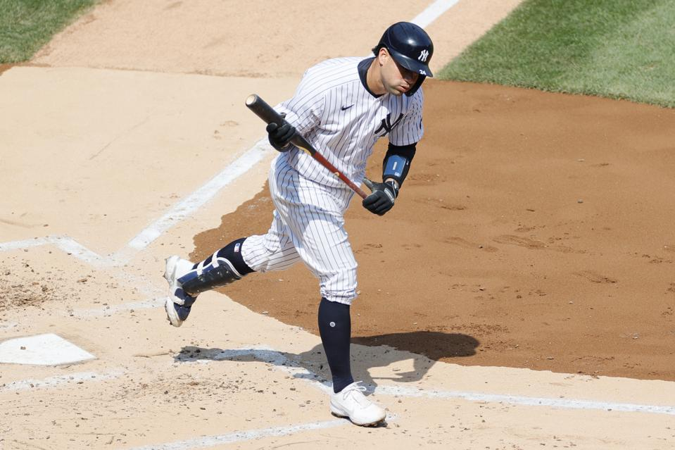 Gary Sanchez trots out of the batters' box in frustration.
