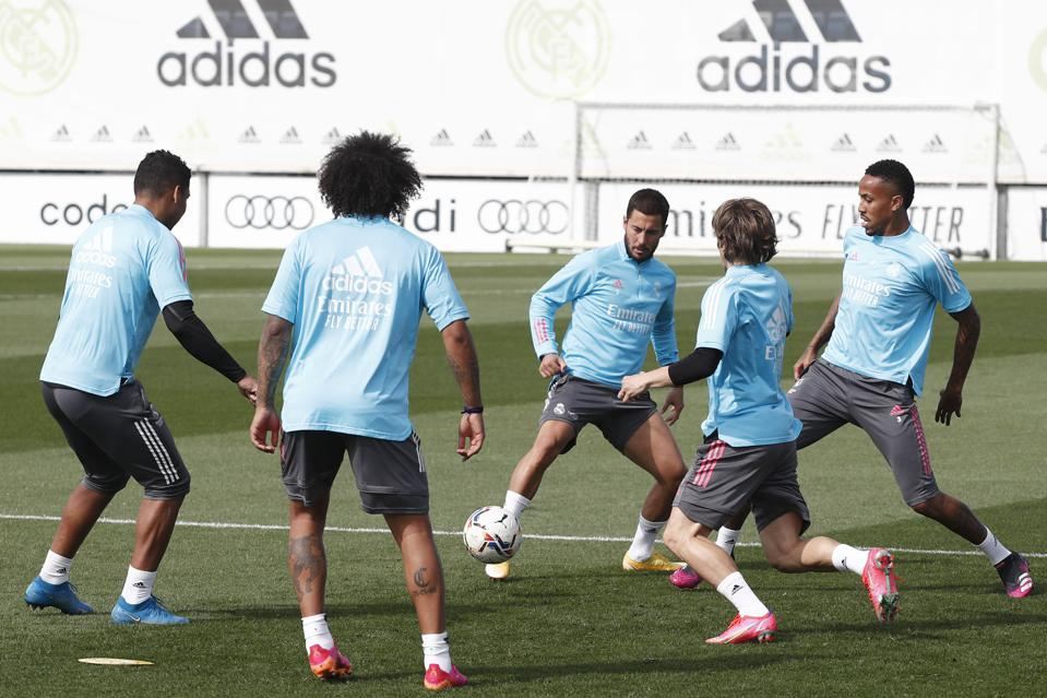 La Liga side Real Madrid's players with the ball during a training session.