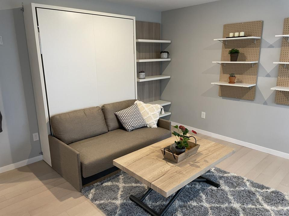 A Murphy bed in the living room can convert the living room into an extra bedroom.