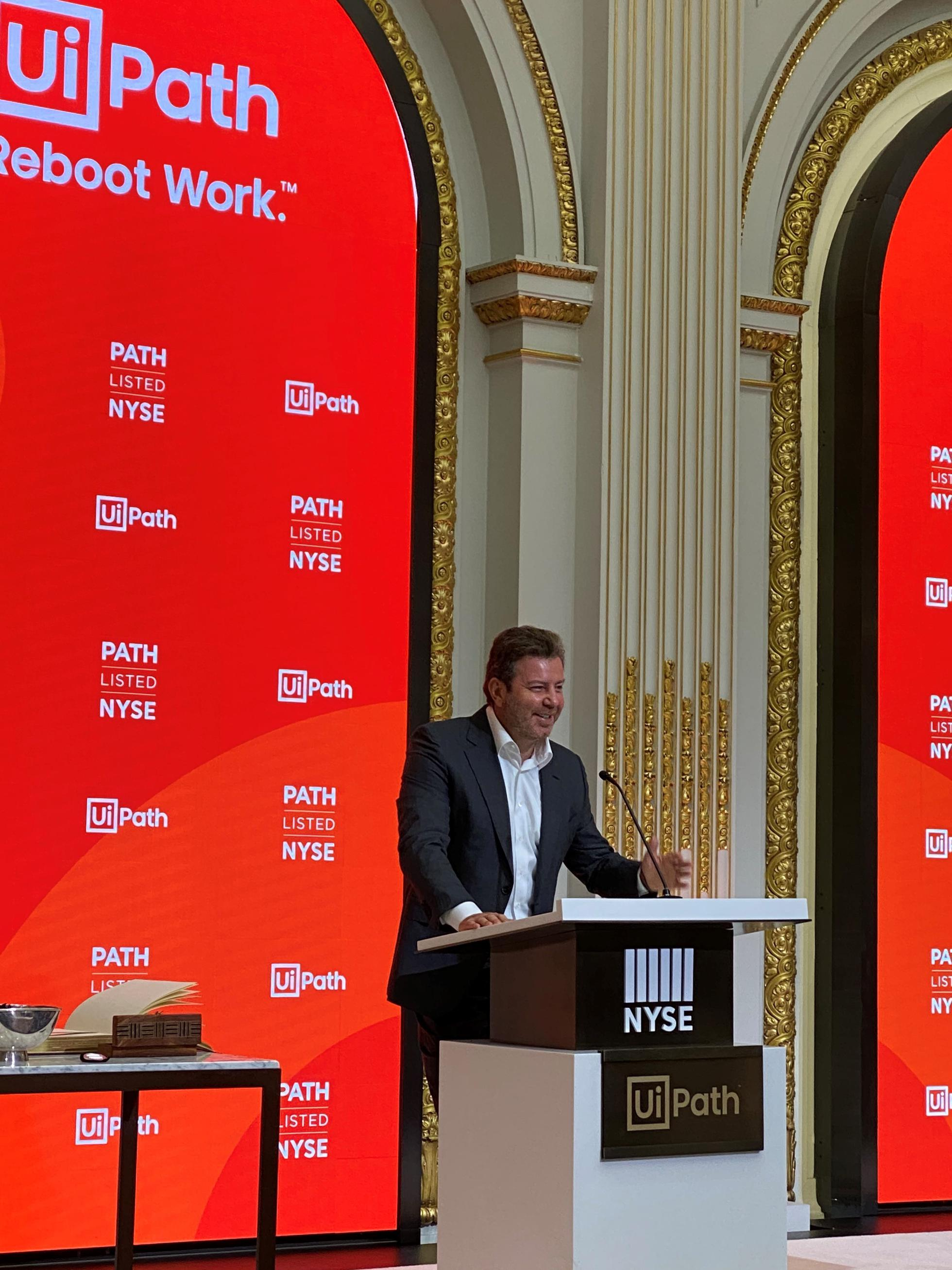 UiPath CEO Daniel Dines speaks at the New York Stock Exchange as his company went public.