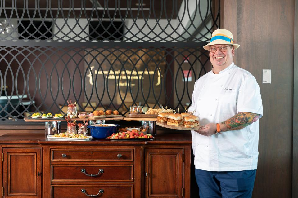 Chef Danielson stands alongside his Kentucky Derby at-home dishes