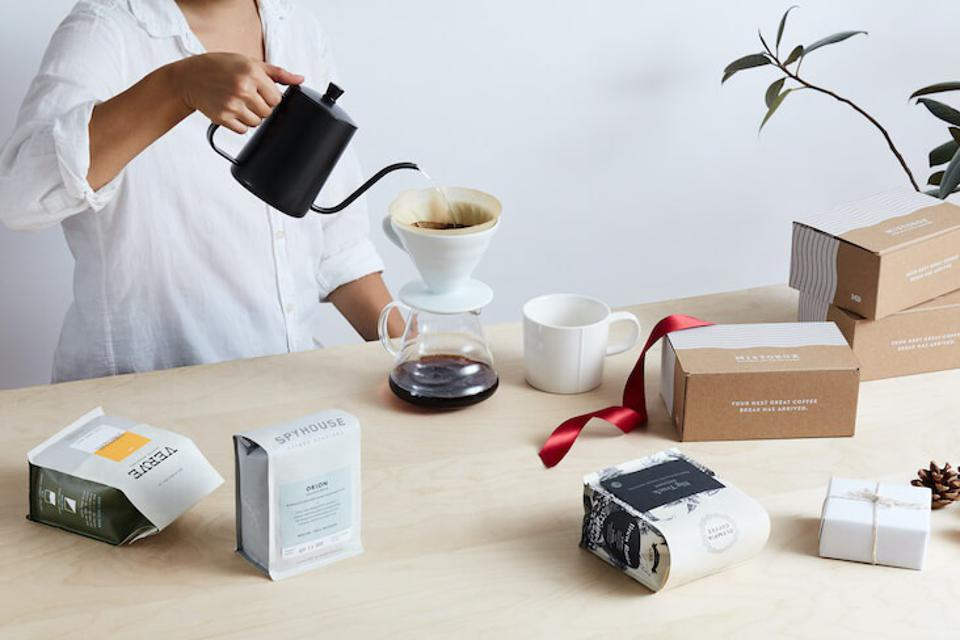 MistoBox coffee subscription box with woman pouring coffee