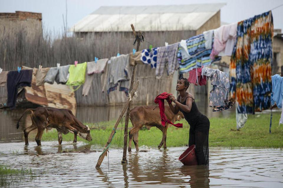 A woman hangs laundry in the displacement camp in Gatumba, near Bujumbura in Burundi, an area devastated by floods and other climate-related shocks.