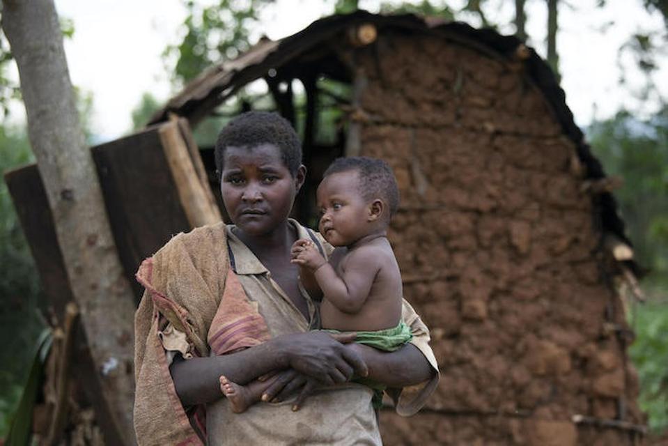 Janviere, 30, holds her nine-month-old daughter Estella near their shelter in Kibande, Burundi.