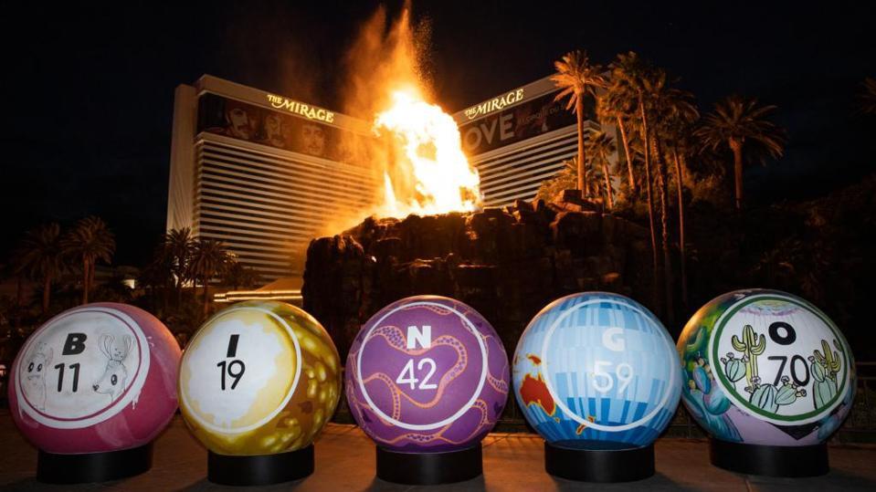 Giant painted bingo balls in front of erupting volcano on Las Vegas Strip