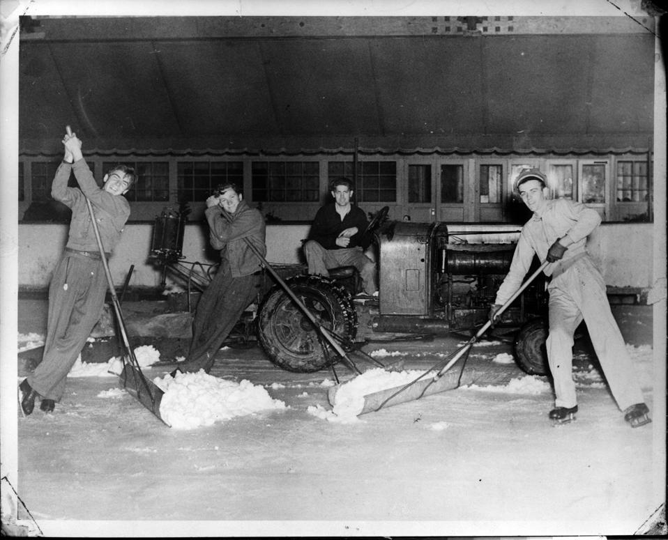 Ice resurfacing the old-fashioned way.