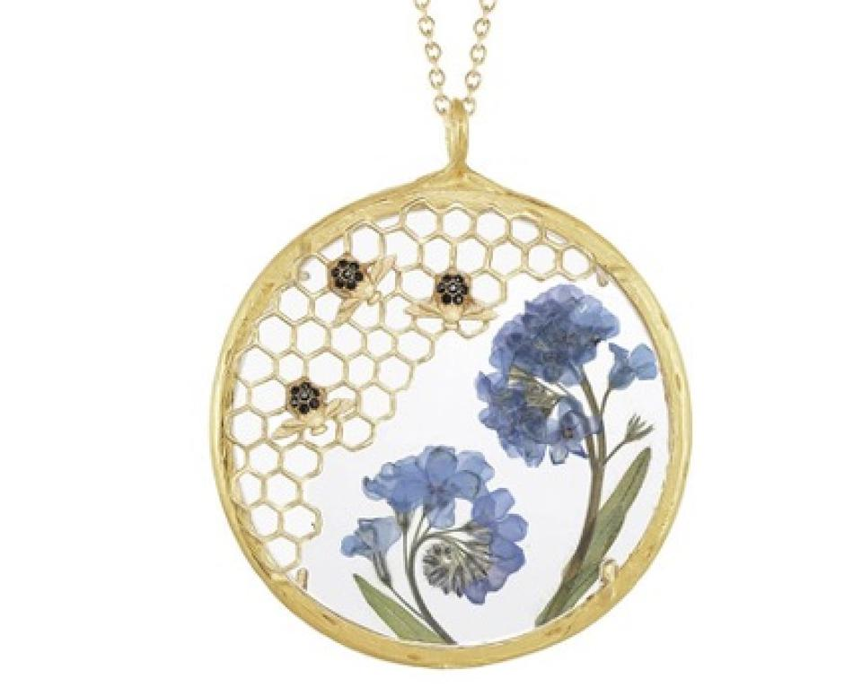 This handmade necklace contains gorgeous pressed Forget-Me-Not flowers.