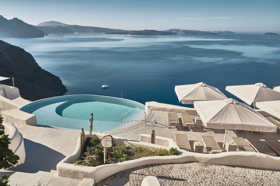 The pool at Mystique resort on Santorini, Greece, is above the Aegean Sea.