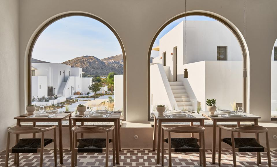 The dining room at Parilio hotel on Paros, Greece, has big arched windows