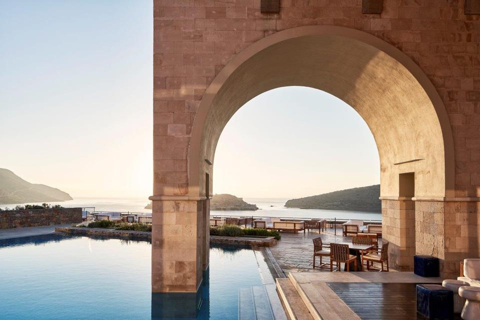 A dramatic arch extends into the pool at Blue Palace Elounda hotel on Crete, Greece