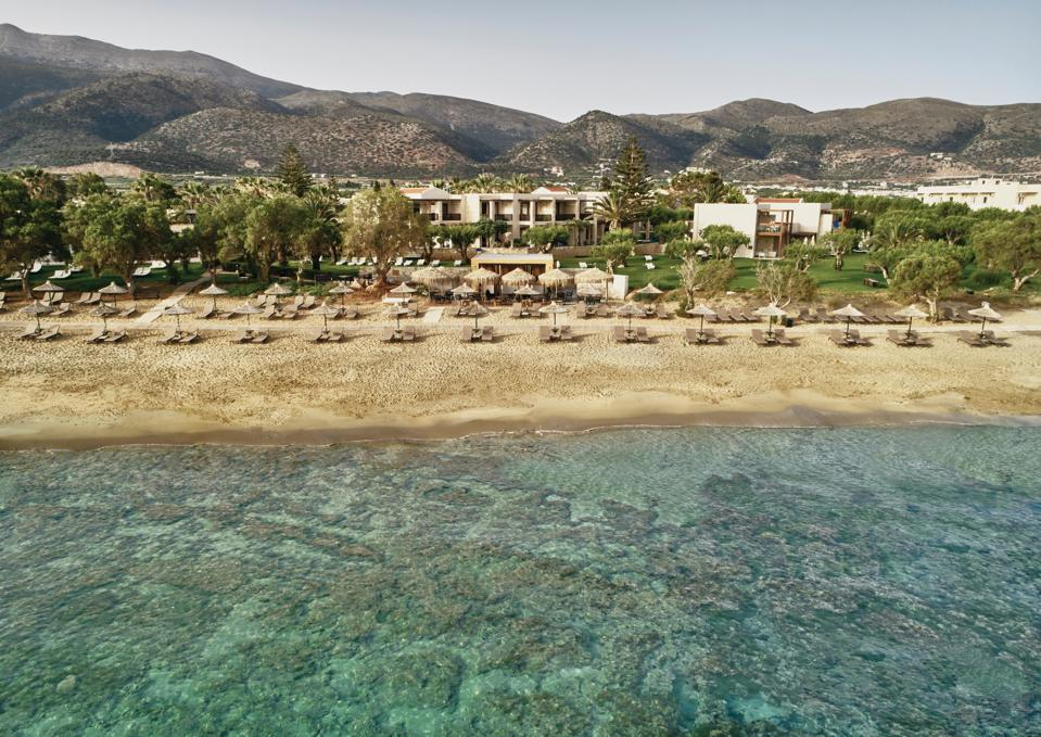 There is clear water beyond the beach at Cretan Malie Resort on Crete, Greece