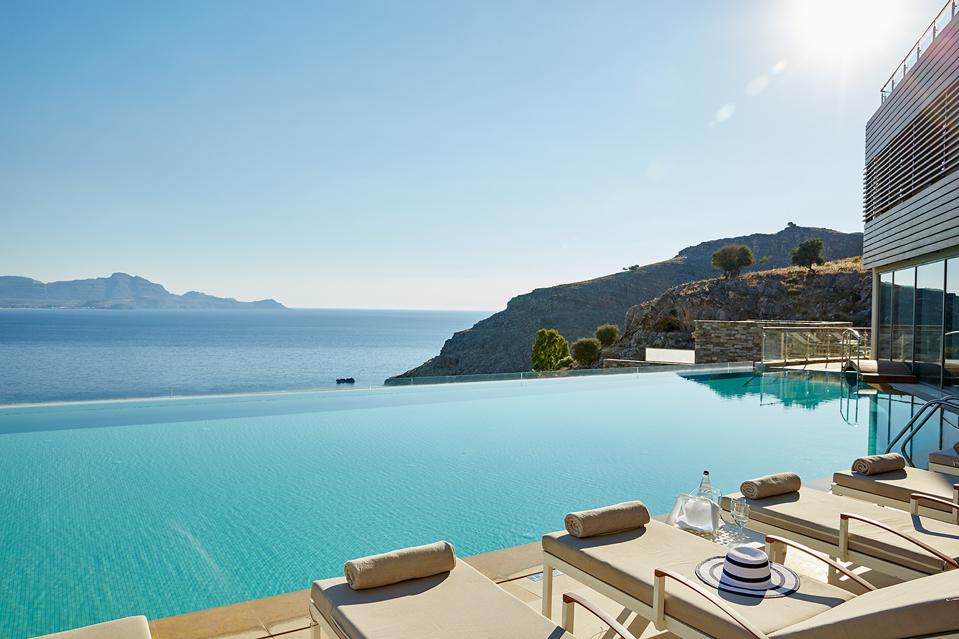 The pool at Lindos Blu hotel on Rhodes, Greece, has great views over the Mediterranean Sea