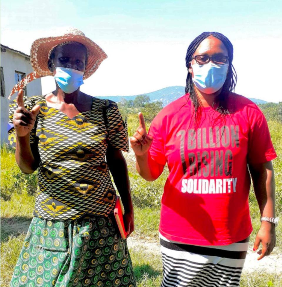Colani Hlatjwako, One Billion Rising Africa Coordinator, with one of the community volunteers, Make Thokozani Mbatha.