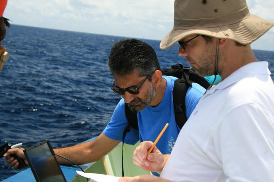 Lamont oceanographers Ajit Subramaniam and Andy Juhl studying the Deepwater Horizon spill in August 2010.