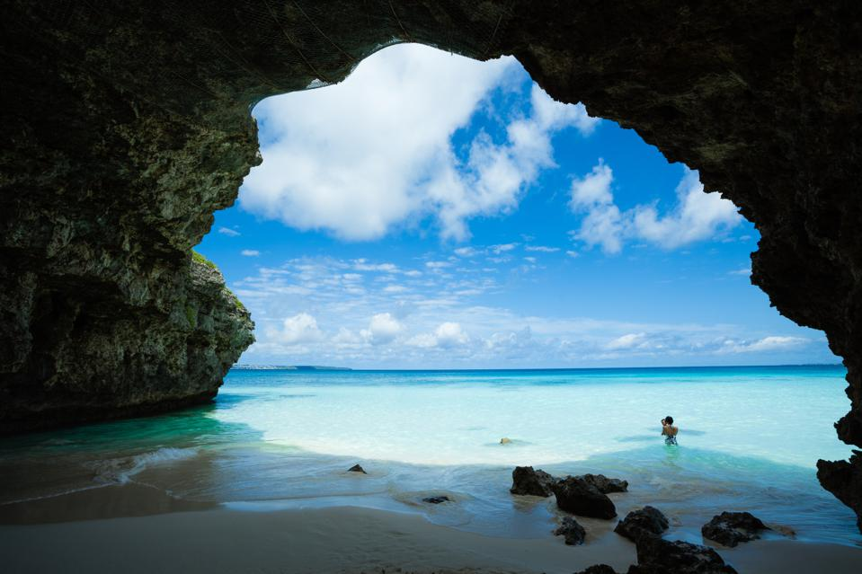 Tropical beach with natural arch, Okinawa, Japan