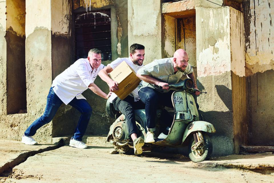 3 Krug Ambassade Chefs having fun on a vintage Vespa in Jaipur, India