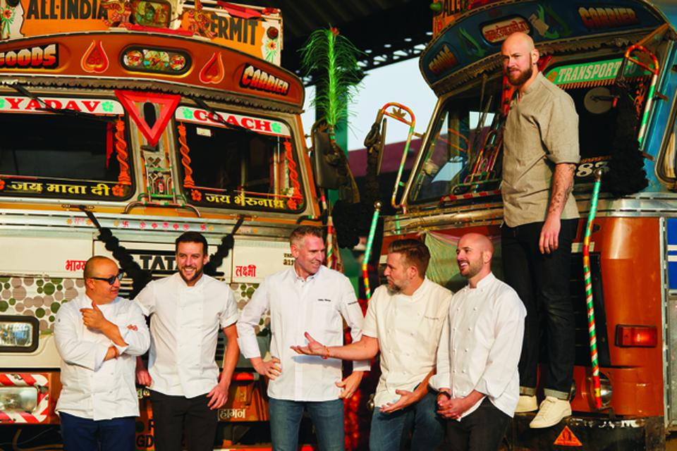 Krug Ambassade Chefs in front of artfully decorated buses in Jaipur, India
