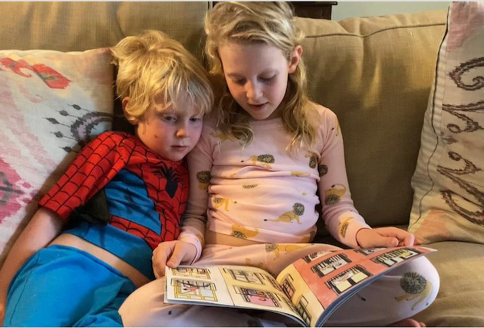 Stephen, 4, and Ella, 6, read ″We Stand Together, Just Six Feet Apart,″ a picture book written by UNICEF UNITE volunteer Dr. Renee Kleris and colleagues to help children understand the coronavirus pandemic.
