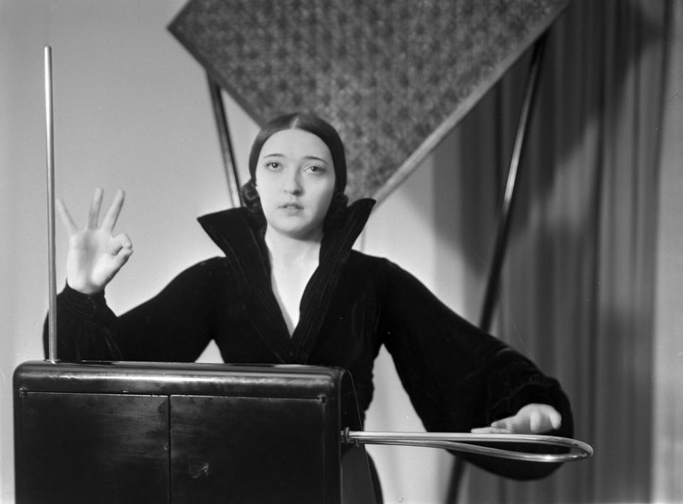 Musician Clara Rockmore playing the theremin, shown facing the camera